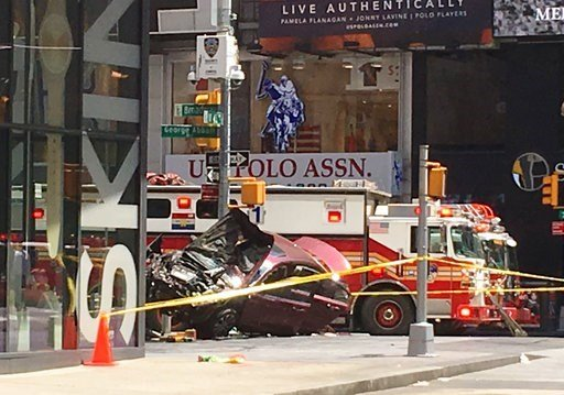 (AP Photo/Seth Wenig). A smashed car sits on the corner of Broadway and 45th Street in New York's Times Square after driving through a crowd of pedestrians Thursday, May 18, 2017.