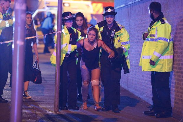 Police and other emergency responders are seen near the Manchester Arena after reports of an explosion on May 22, 2017. REX FEATURES/SHUTTERSTOCK/AP