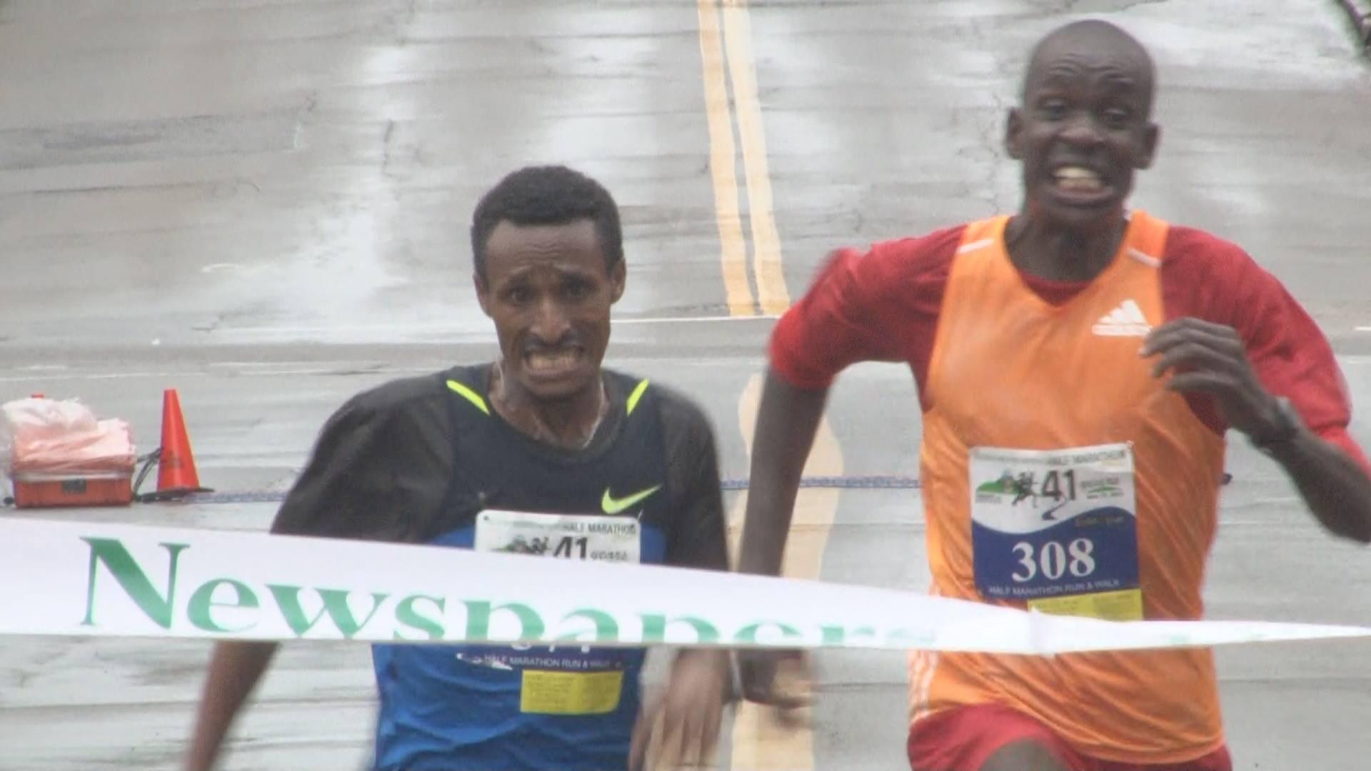 Half marathon winner crossing the finish line