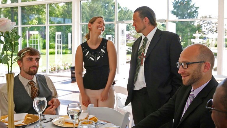 Sarah Cummins talks with men from Wheeler Mission, at the Ritz Charles, Saturday, July 15, 2017. Cummins called off her wedding which was supposed to be this day. She decided to bring purpose to her pain by inviting area homeless to enjoy the reception.