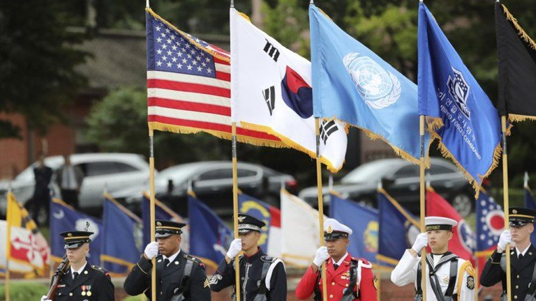U.N. Command honor guards carry flags of the United States, the United Nations and South Korea during a change of command and change of responsibility ceremony.
