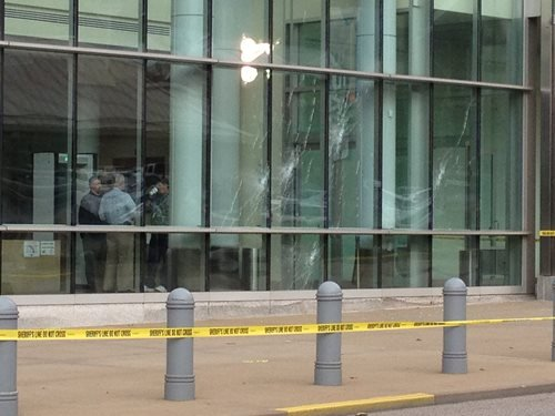 Bullet holes can be seen at the federal building in Wheeling.