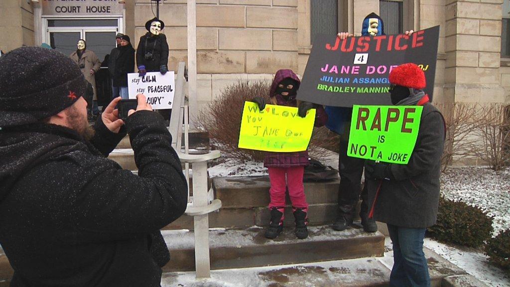 File Photo/Protestors are shown during the Steubenville rape trial.