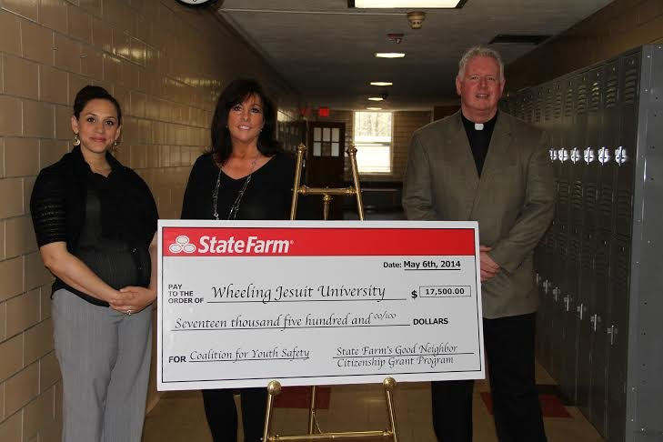 Bethany Moore & Cindy Nickerson, state farm agents with WJU President Fr. Jim Fleming.